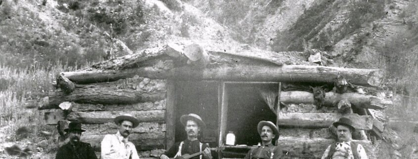 men-in-front-of-hut-1860s