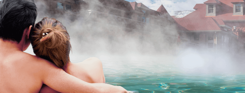 couple in hot springs pool