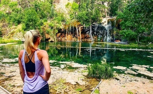 Woman looking at Hanging Lake