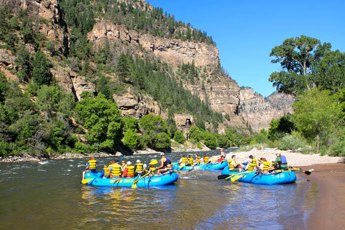 3 boats whitewater rafting in Glenwood Canyon