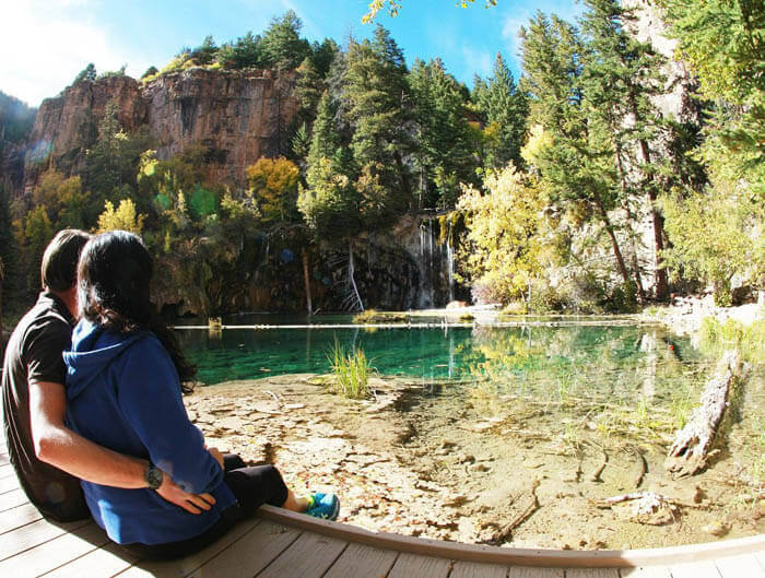 Couple sitting at Hanging Lake