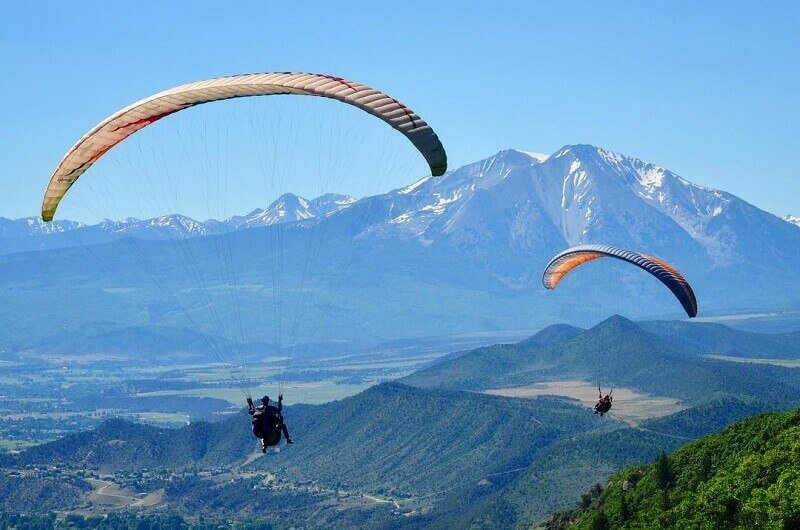 two paragliders and mount sopris