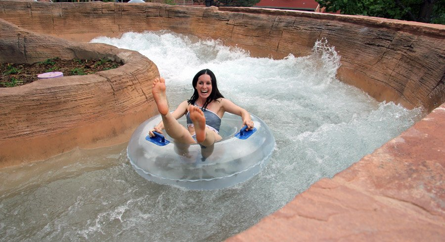 Women floating in Adventure River in a tube at Glenwood Hot springs