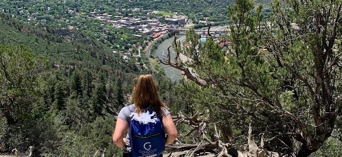 Woman looking at view of Glenwood Springs from Boy Scout Trail