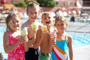 kids laughing and holding ice-cream