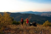 two men and an atv in the colorado backcountry