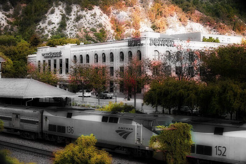 glenwood springs train station with train in front of hotel denver