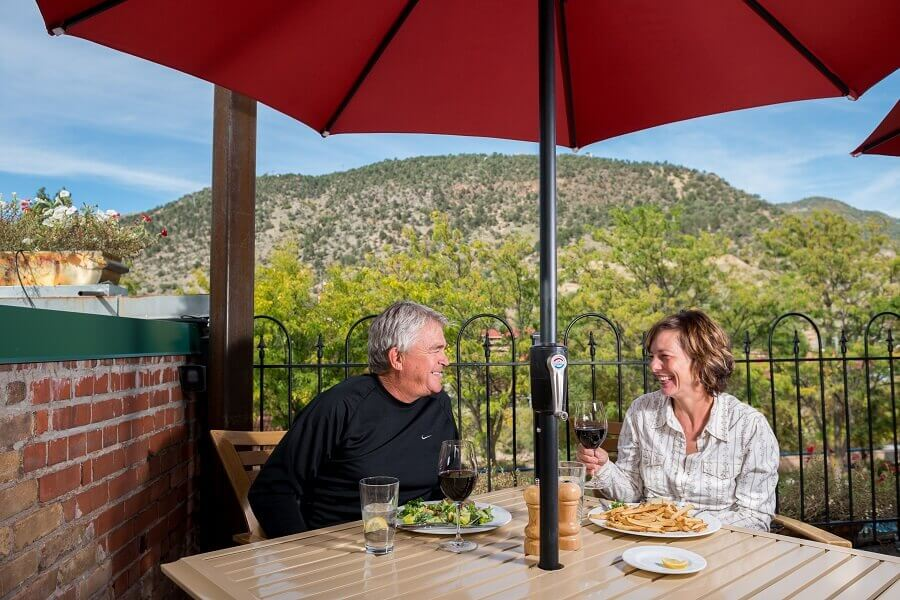 couple dining on Juicy Lucy's rooftop
