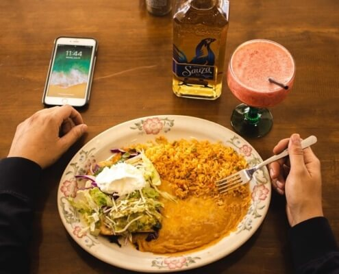 plate and phone and tequila bottle