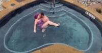 couple kissing in heartshaped hot springs pool
