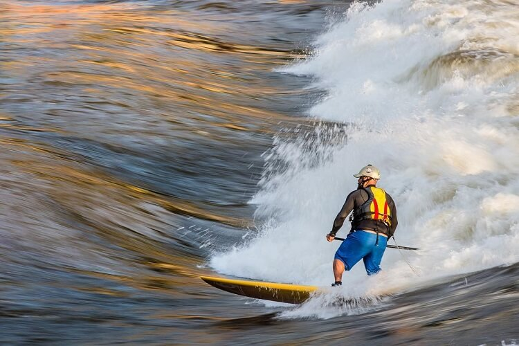 surfing in whitewater wave