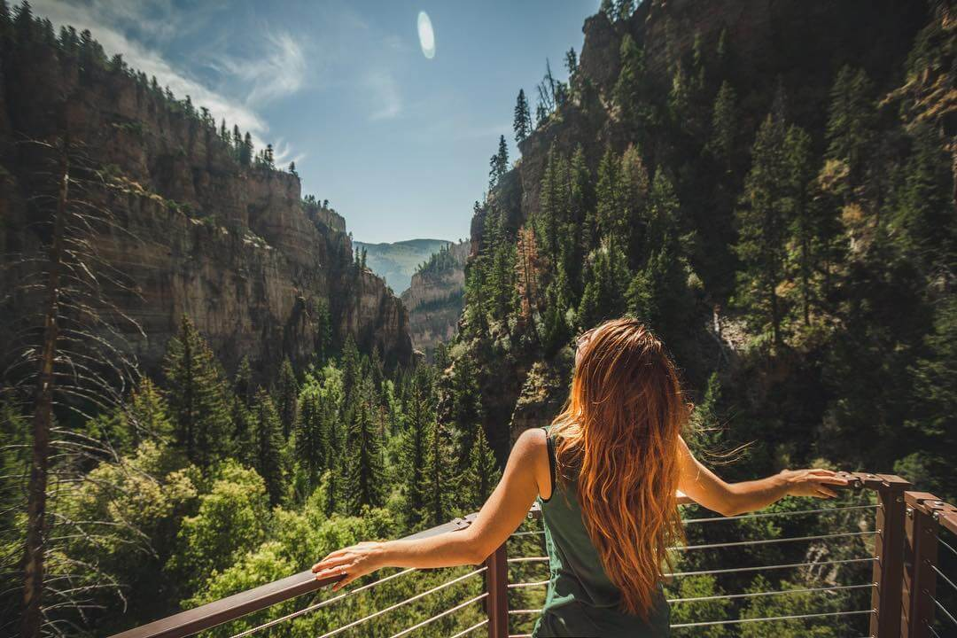 women standing at lookout spot on hanging lake hike