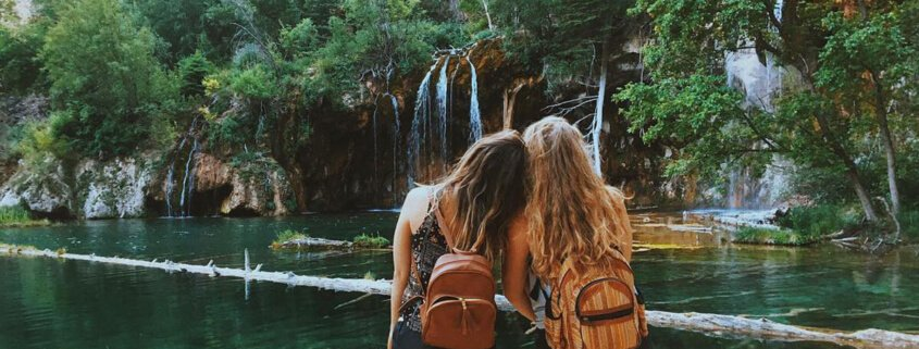 girls standing in front of hanging lake
