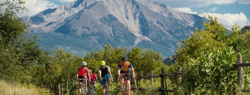 three bikers on rio grand trail with mount sopris in the background