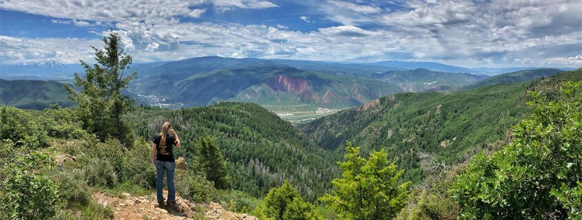 hiker with view of Glenwood Springs