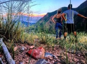 couple hiking with sunset